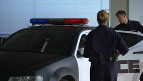 Police officers arresting hooligan, aiming gun and putting him in patrol car. Stock footage stock video