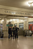 Police officers assist tourist at Grand cetral Terminal. NEW YORK CITY - JANUARY 10, 2015: New York MTA police assist travellers  at Grand Central Terminal Royalty Free Stock Photography