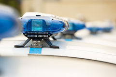 Police officers cars warning lightbars Stock Photography