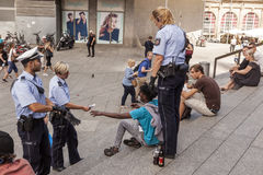Police officers check a refugee in Cologne, Germany royalty free stock photos