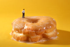 Police Officers in Conceptual Food Imagery With Doughnuts Royalty Free Stock Photos