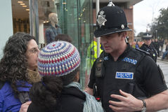 Police officers confonts two Occupy Exeter Royalty Free Stock Photography