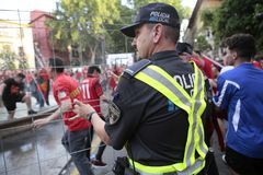 Police officers controlling Mallorca soccer fans celebrations. Local police officers control while Mallorca soccer team supporters celebrate on a fountain Stock Photos