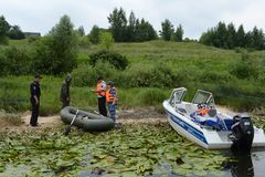 Police officers draw up a protocol for poaching on the river. RYAZAN, RUSSIA - JUNE 16, 2015: Police officers draw up a protocol for poaching on the river Royalty Free Stock Photos