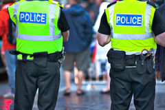 Police officers on duty. Police officers with bright yellow vests on duty Royalty Free Stock Images