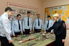 Police officers examine the layout features of the train station. PODOLSK, RUSSIA - MARCH 26, 2015: Police officers examine the layout features of the train stock photos