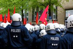 Police Officers Face Protesters Stock Photo