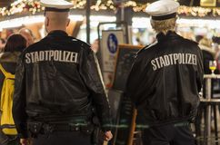 Police officers at German Christmas market royalty free stock images