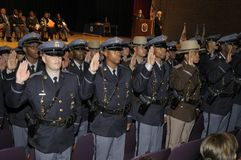 Police officers get sworn in at the police graduation in Greenbelt, Maryland. Prince George`s County police and deputy sheriffs get sworn in at the police stock photo