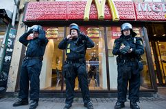 Police Officers Guarding a McDonald's Royalty Free Stock Image