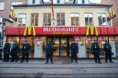 Police Officers Guarding a McDonald's in Denmark Stock Images