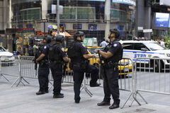 Police Officers Guarding Times Square. New York, NY USA -- Aug 3, 2016 New York City Police Officers provide security for Times Square. Editorial Use Only Royalty Free Stock Image