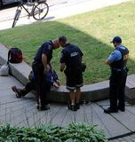 Police officers handcuff man in Kitchener, Ontario, Canada stock image