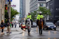 Police officers on horses in downtown Toronto Royalty Free Stock Images