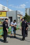 Police officers inspect the documents on the streets of Moscow. Stock Photography