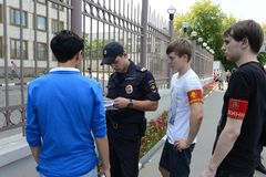 Police officers inspect the documents on the streets of Moscow. Royalty Free Stock Photos