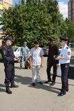 Police officers inspect the documents on the streets in the suburban town of Khimki Stock Photos