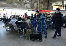 Police officers inspect the waiting room Paveletsky station of capital service dog. Stock Image