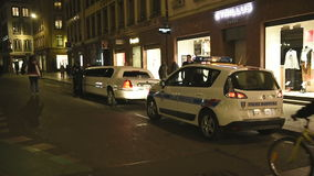 Police officers inspecting a limousine stock video