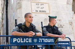 Police officers in Jerusalem. ISRAEL, JERUSALEM - OCTOBER 07, 2014: Two police officers are taking care of the security in the old city of Jerusalem on the via Royalty Free Stock Photos