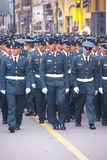 Police officers marching in parade Stock Photos