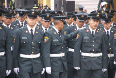 Police officers marching in parade Stock Photo