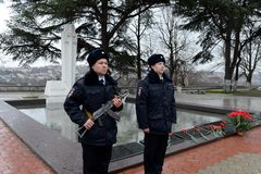 Police officers at the monument to police officers who died during the defense of Sevastopol in 1941-1942. SEVASTOPOL, REPUBLIC OF CRIMEA,  RUSSIA - MARCH 11 Stock Photo