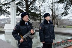 Police officers at the monument to police officers who died during the defense of Sevastopol in 1941-1942. SEVASTOPOL, REPUBLIC OF CRIMEA- MARCH 11, 2015 Royalty Free Stock Photography