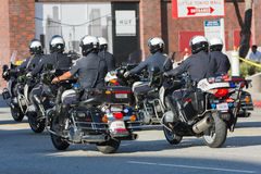 Police officers on motorcycles performing Royalty Free Stock Photos