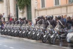 Police officers with motorcycles stand in raw.