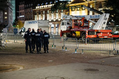 Police officers on near Central Christmas tree. STRASBOURG, FRANCE - 14 NOV 2015: Police officers on near Central Christmas tree in the center of Strasbourg for Royalty Free Stock Image