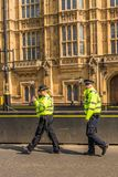 Police officers in parliament square London stock images