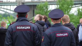Police Officers at Rally, Police keeps order at a rally