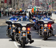 Police officers riding motorcycles in parade. Saint patrick day parade 2016 Male bike cops Hartford Connecticut Stock Image