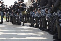 Police officers in riot gear at Pushkin Square during an opposition protest rally ahead of President Vladimir Putin`s inauguratio Stock Photography