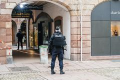 Police officers securing the crime zone on rue des orfevres in S royalty free stock photo