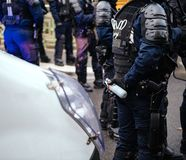 Police officers securing the zone in front of Yellow Jackets Gil. French Police officers securing the zone in front of the yellow vests movement protesters on stock photos