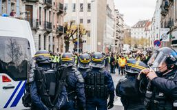 Police officers securing the zone in front of Yellow Jackets Gil. STRASBOURG, FRANCE - DEC 8, 2018: Police officers in front of the Yellow vests movement royalty free stock photography