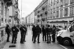 Police officers securing the zone in front of Yellow Jackets Gil. STRASBOURG, FRANCE - DEC 8, 2018: Rear view of police officers securing the zone in front of stock images