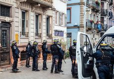 Police officers securing the zone in front of Yellow Jackets Gil. STRASBOURG, FRANCE - DEC 8, 2018: Rear view of police officers securing the zone in front of stock photos