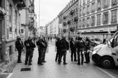 Police officers securing the zone in front of Yellow Jackets Gil. STRASBOURG, FRANCE - DEC 8, 2018: Police officers securing the zone in front of the Yellow royalty free stock images