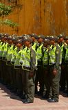 Police Officers Stand at Attention in Cartagena. Colombian police officers stand at attention as they receive instructions from a superior in the Plaza de la Paz Stock Images
