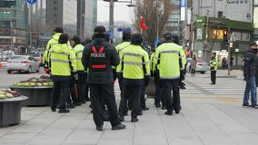 Police officers staying near gwanghwamun square, Seoul, South Korea, 02 December 2017. Police officers staying near gwanghwamun square during political stock footage
