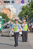 Police officers on the street during rush hour, Kunming, China Royalty Free Stock Image