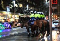 Police officers Australia. Australian Police officer patrolling on Swanston Street Melbourne Australia Friday night stock image