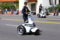 Police Officers on Three-Wheel Segways Royalty Free Stock Photo