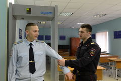 Police officers are trained to work on inspection equipment. PODOLSK, RUSSIA - MARCH 26, 2015:Police officers are trained to work on inspection equipment Royalty Free Stock Image