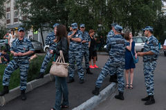 The police OMON - standing in the cordon, and talking with the ladies. Russia , Moscow,25 july 2016 stock photo