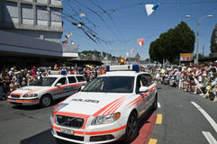 Police parade. Police cars opening the space in the crowd for the jodler's parade, Luzern, Switzerland. A folkloristic event called Jodlerfest which took place Stock Photo