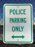Street sign indicating Police parking only with arrows. A street sign indicating police parking only with a double arrow royalty free stock image